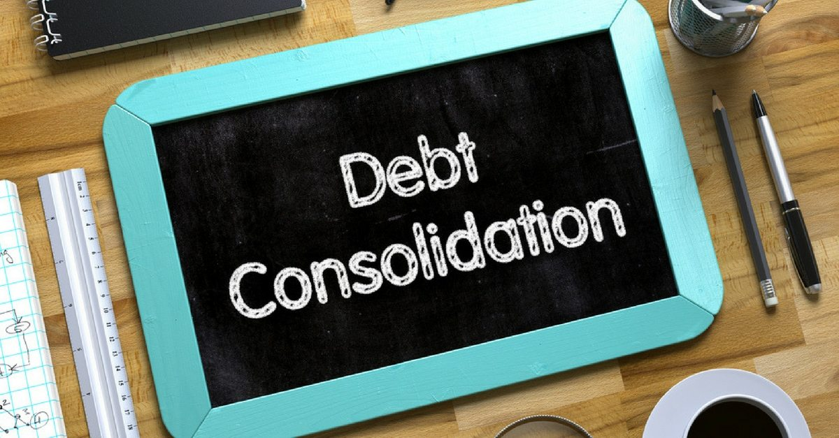Debt concidation of tablet besides a ruler and pens