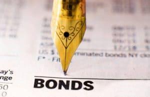 Golden fountain pen nib on a paper written Bonds