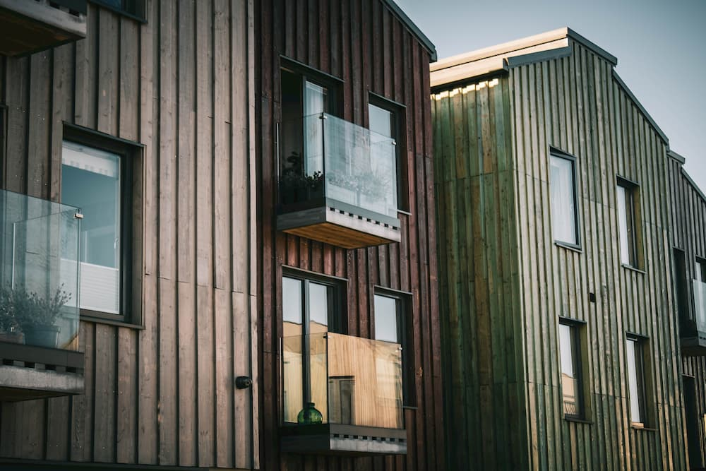 Wooden buildings with glass balcons.