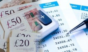 GBP with a calculator and balance sheet