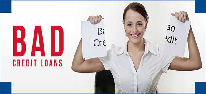 smiling woman tearing a paper writtern bad credit illustrating bad credit loans