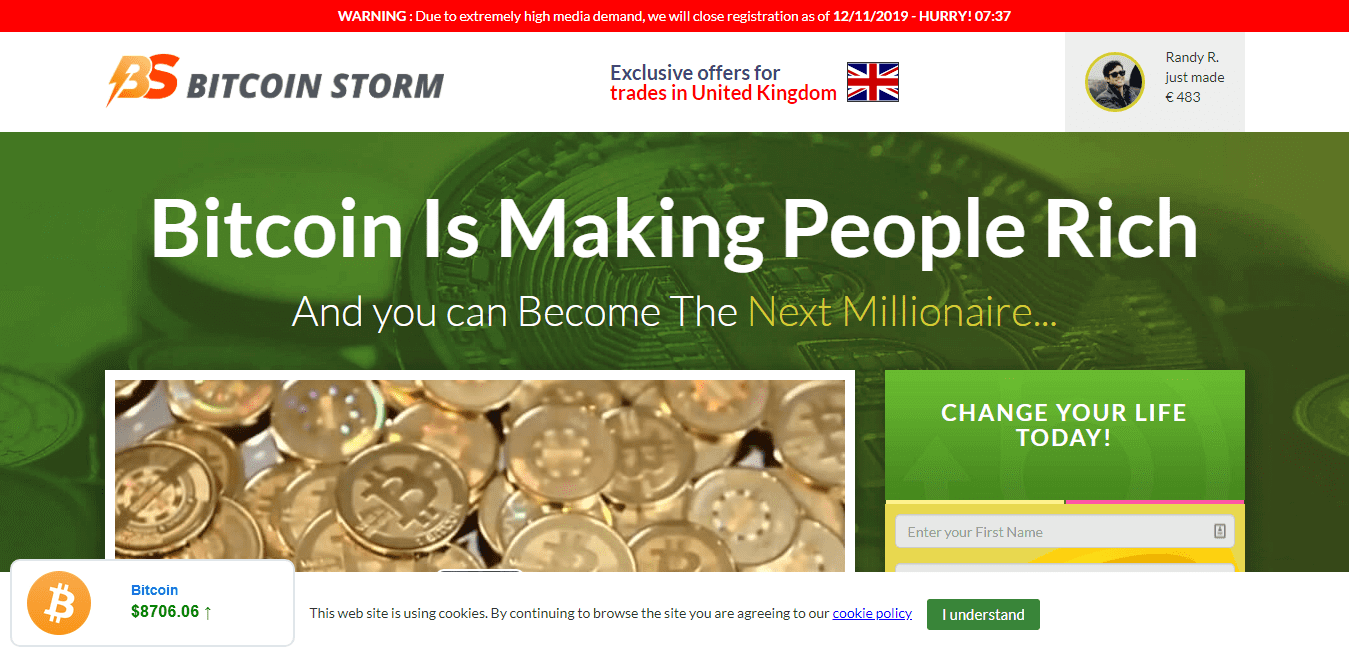 Bitcoin coins on Bitcoin Storm home page alongside registration form: Bitcoin Storm Review