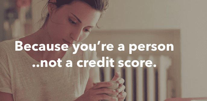 Woman facedown holding a cup termed because you are a person not a credit score