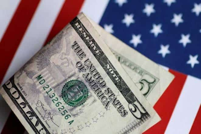 US flag and 5 USD bill is in the image.