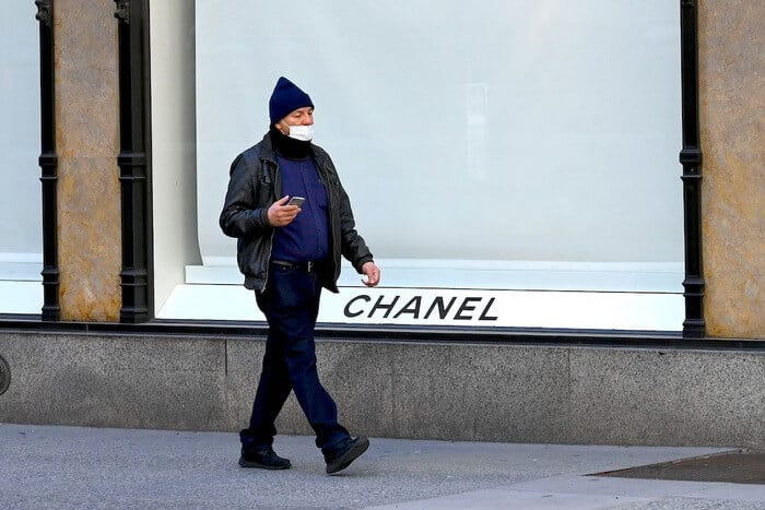 Man walking by closed Chanel boutique