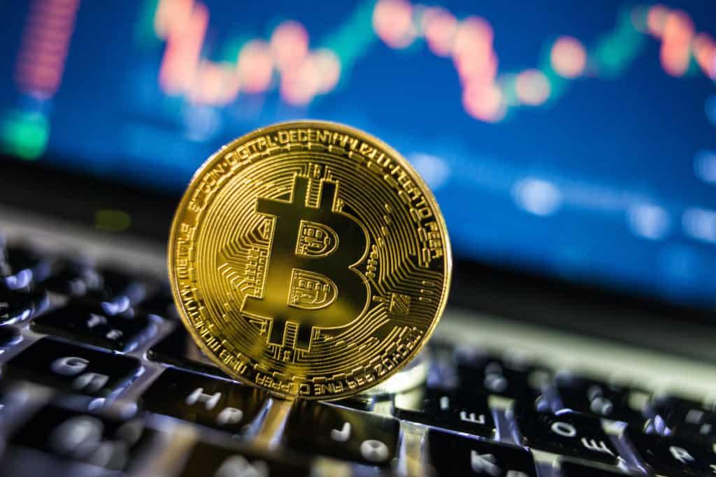 Bitcoin coin on keyboard
